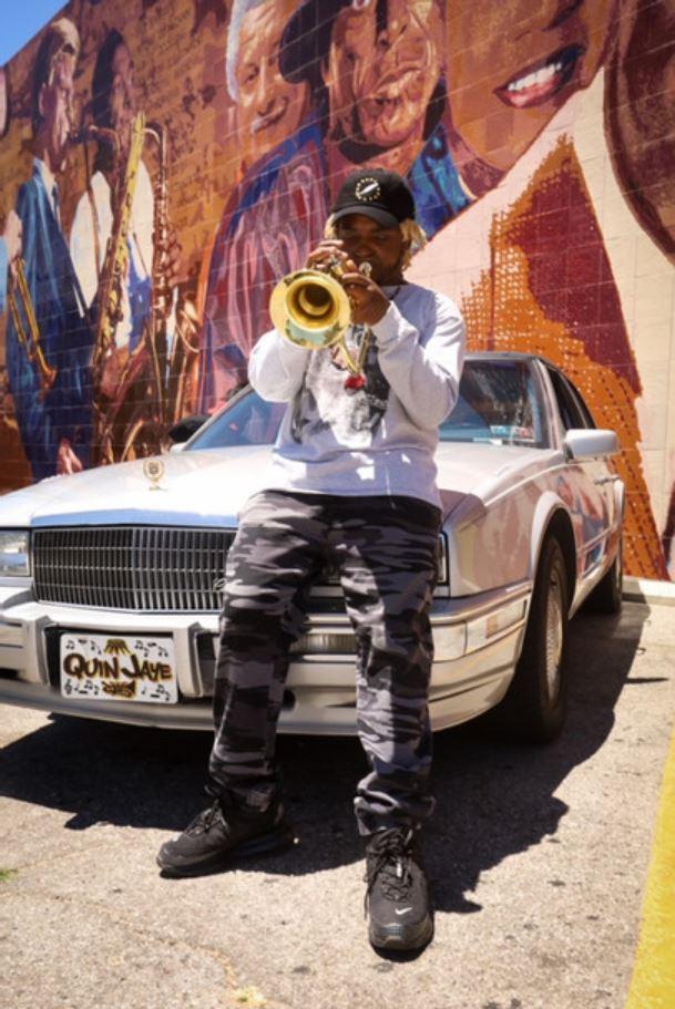 Quin Jaye playing trumpet
